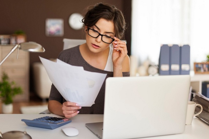 28183669 - young woman hard working at home